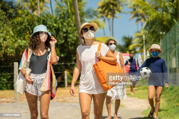 family on the beach during coronavirus pandemic - uv protection stock pictures, royalty-free photos & images