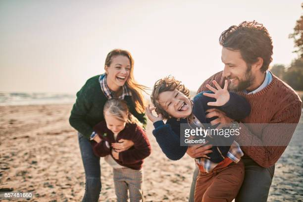 family on the beach - family with two children stock photos and pictures