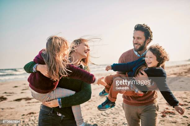 family on the beach - northern european descent stock pictures, royalty-free photos & images