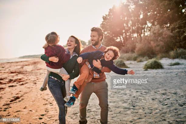 family on the beach - family stock pictures, royalty-free photos & images