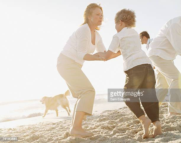 Family on the beach with dog