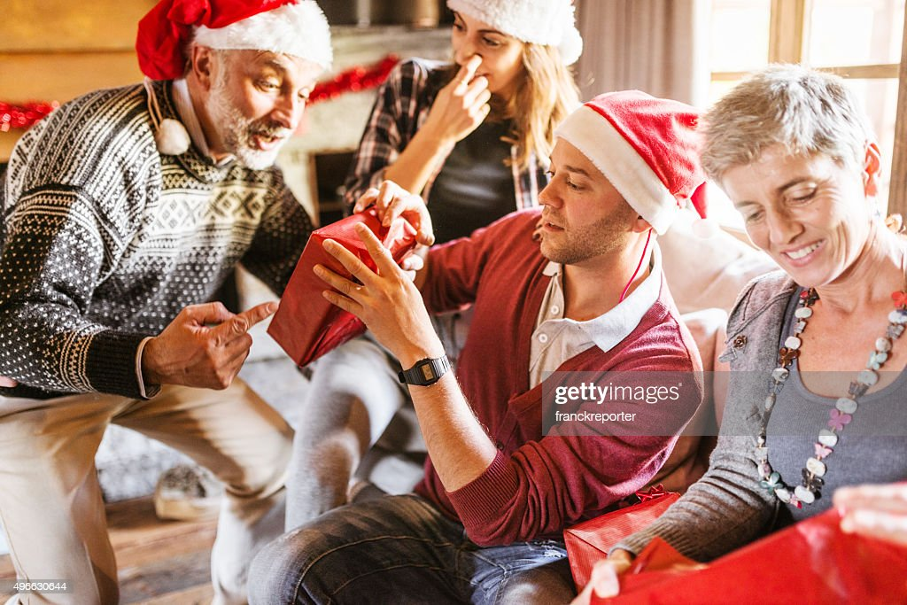 family on the living room for christmas opening the presents : Stock Photo