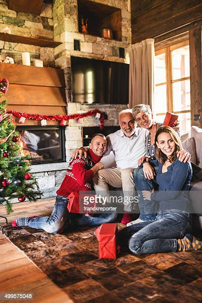 family on the living room for christmas opening the presents