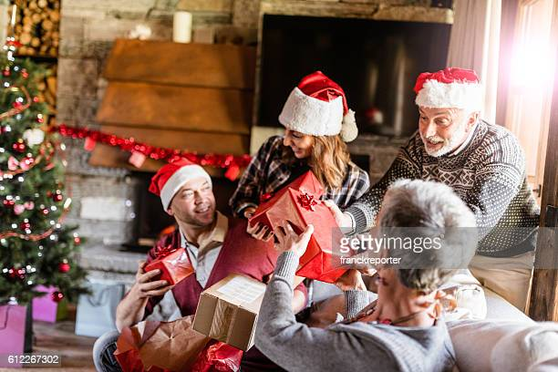 family on the living room for christmas - giving stock pictures, royalty-free photos & images