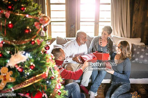 family on the living room for christmas - open grave stock photos and pictures