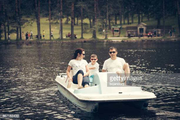 family on the pedal boat - pedal boat stock pictures, royalty-free photos & images