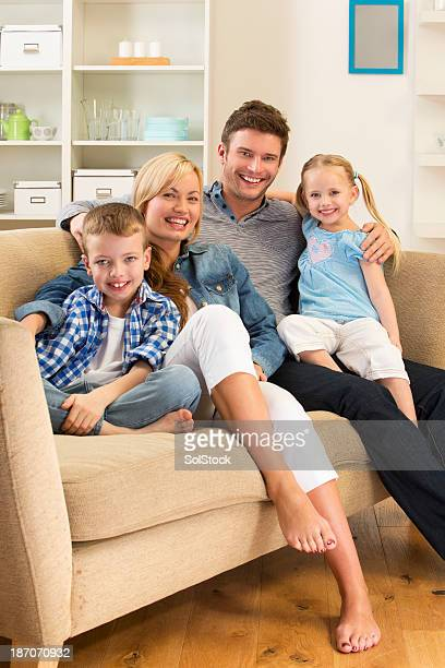 family on the sofa - barefoot photos stock photos and pictures