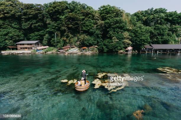 family on traditional tub boat of sadoshima in sea, niigata, japan - 新潟県 ストックフォトと画像