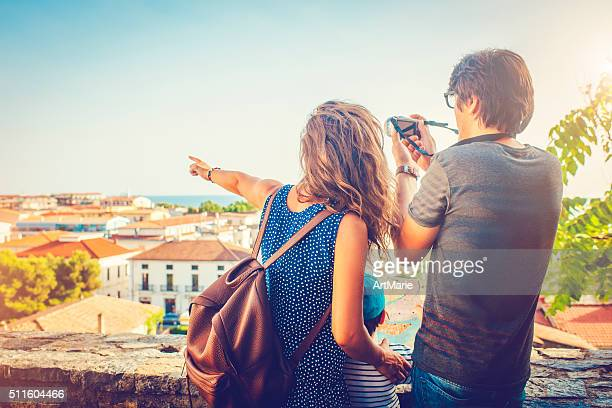 family on vacations - pointing at camera stock photos and pictures