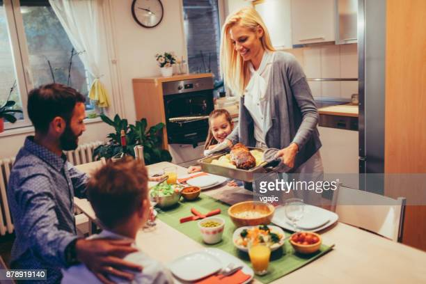 family on weekend luch at home - roast dinner stock pictures, royalty-free photos & images