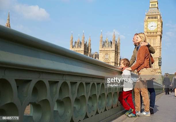 family on westminster bridge looking at view - international landmark stock pictures, royalty-free photos & images