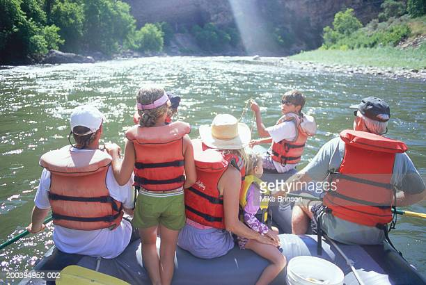 family on whitewater rafting trip, rear view - colorado stock pictures, royalty-free photos & images