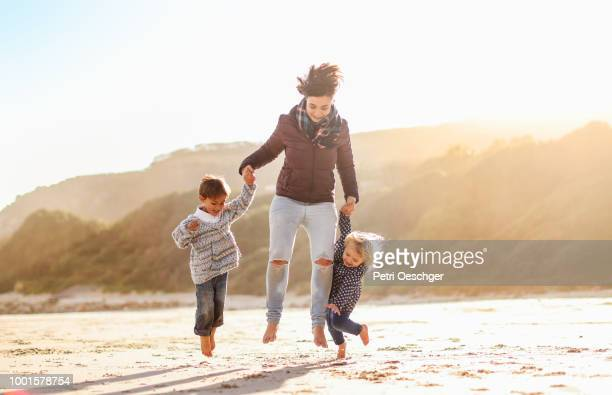 family on winter beach. - beautiful beach babes stock pictures, royalty-free photos & images