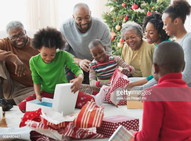 Family opening Christmas presents together