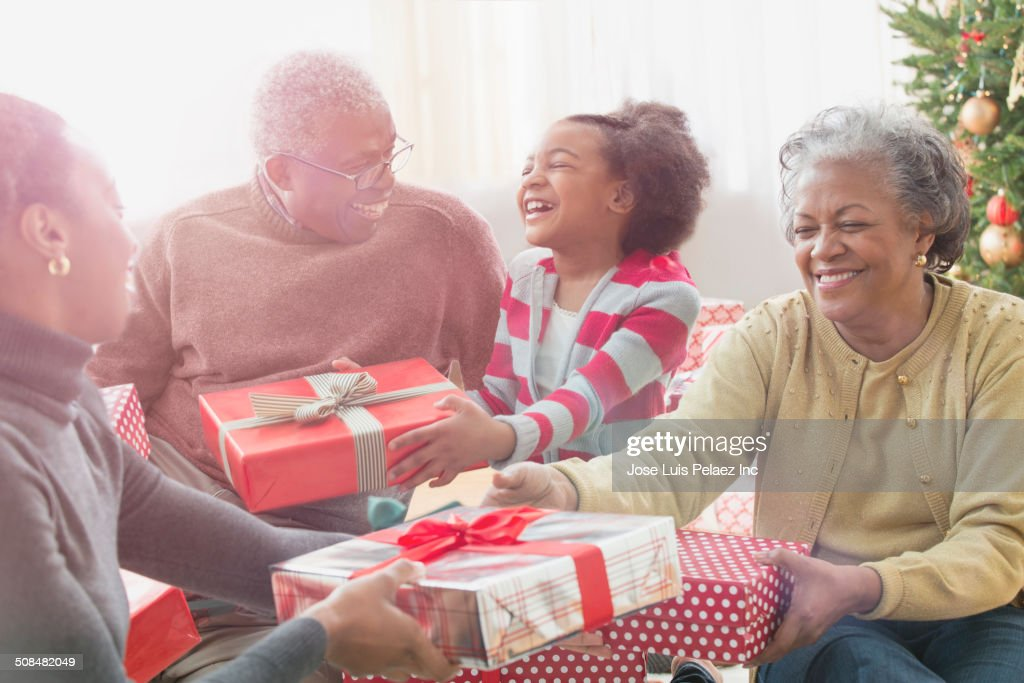 Family opening Christmas presents together : Stock Photo