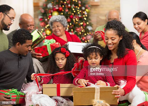 Family opening presents at Christmas