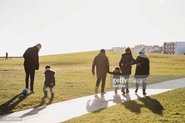 family out for a walk - in law relations stock pictures, royalty-free photos & images