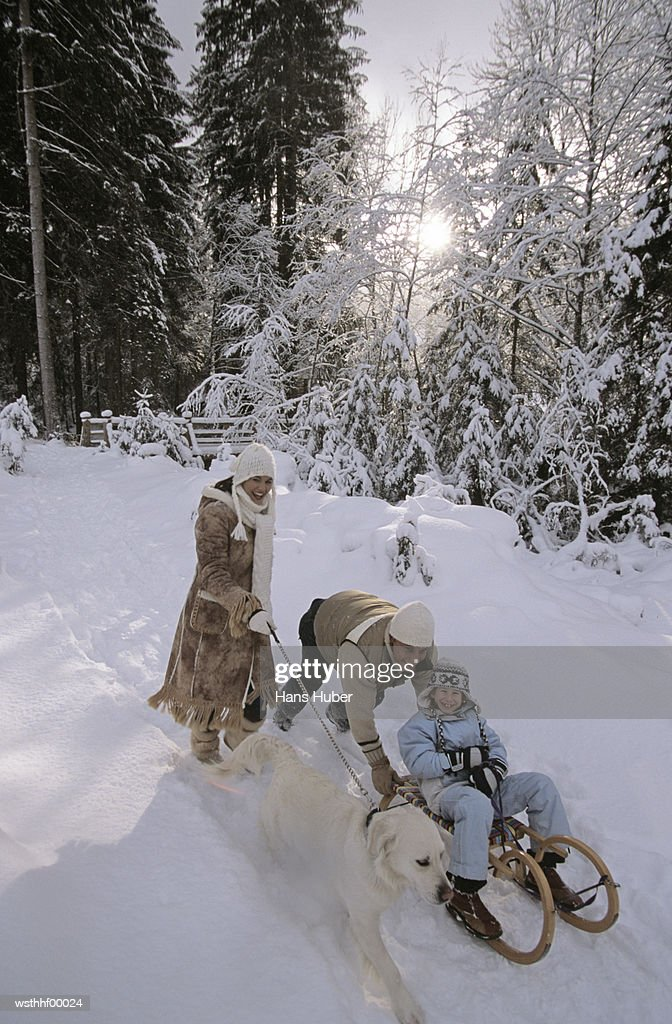 Family out in snow : Stock Photo