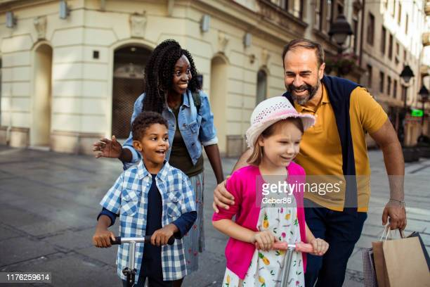 family out shopping - stepfamily stock photos and pictures