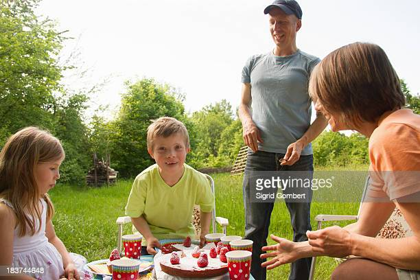 family outdoors having birthday picnic - sigrid gombert imagens e fotografias de stock