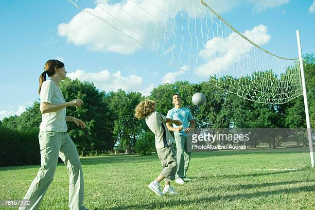 Family outdoors playing volleyball