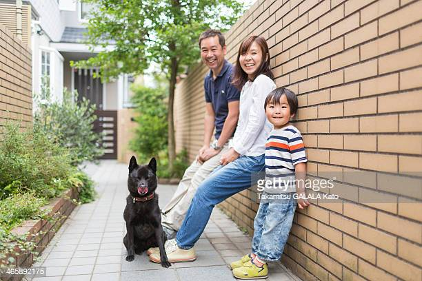 Family outdoors with pet dog