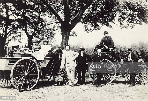 Family outing, 1891. Carl Benz and his family are shown with their automobiles.