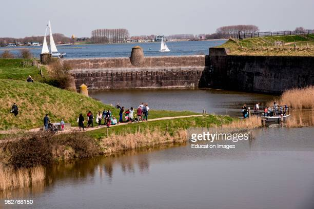 Family outing along a dike in Veere, Netherlands.