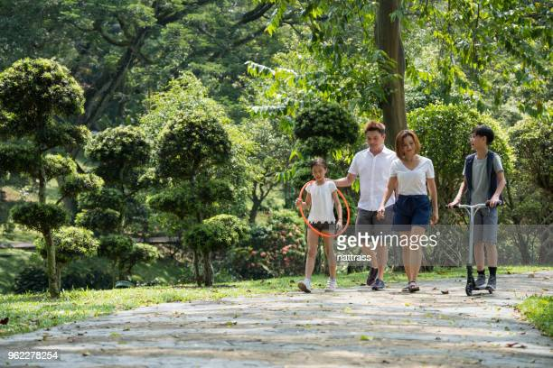 family outing to the park - natural parkland stock pictures, royalty-free photos & images