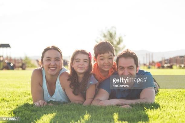 family outing to the playground - middle class stock pictures, royalty-free photos & images