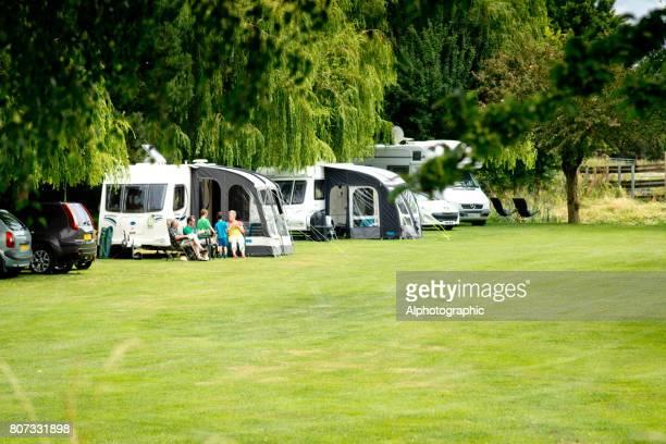 A family outside their caravan