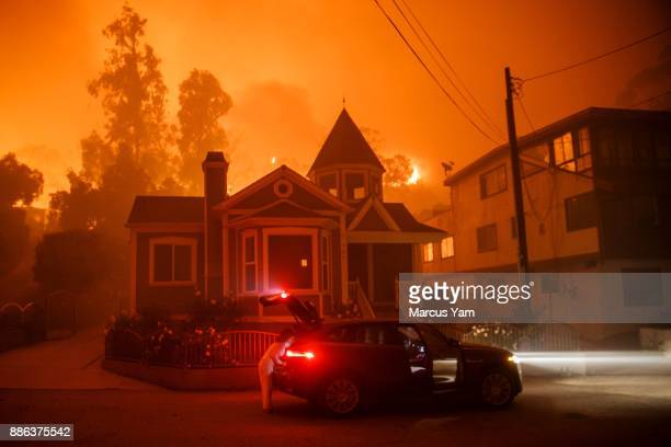 A family pack up and evacuate as a brushfire get closer to their home on December 5 2017 in Ventura California