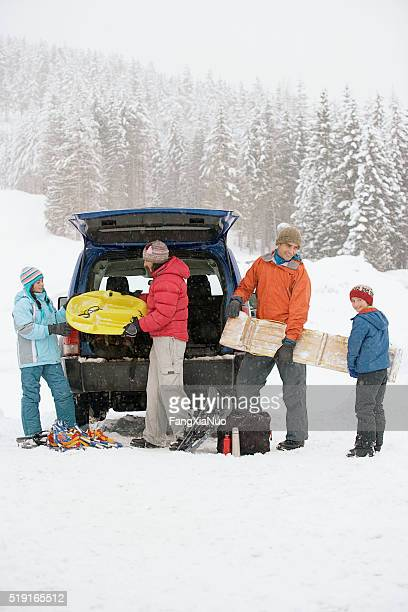 Family packing car at ski hill