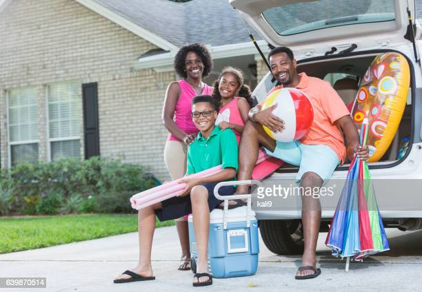 family packing car for trip to the beach or pool - black boot stock pictures, royalty-free photos & images