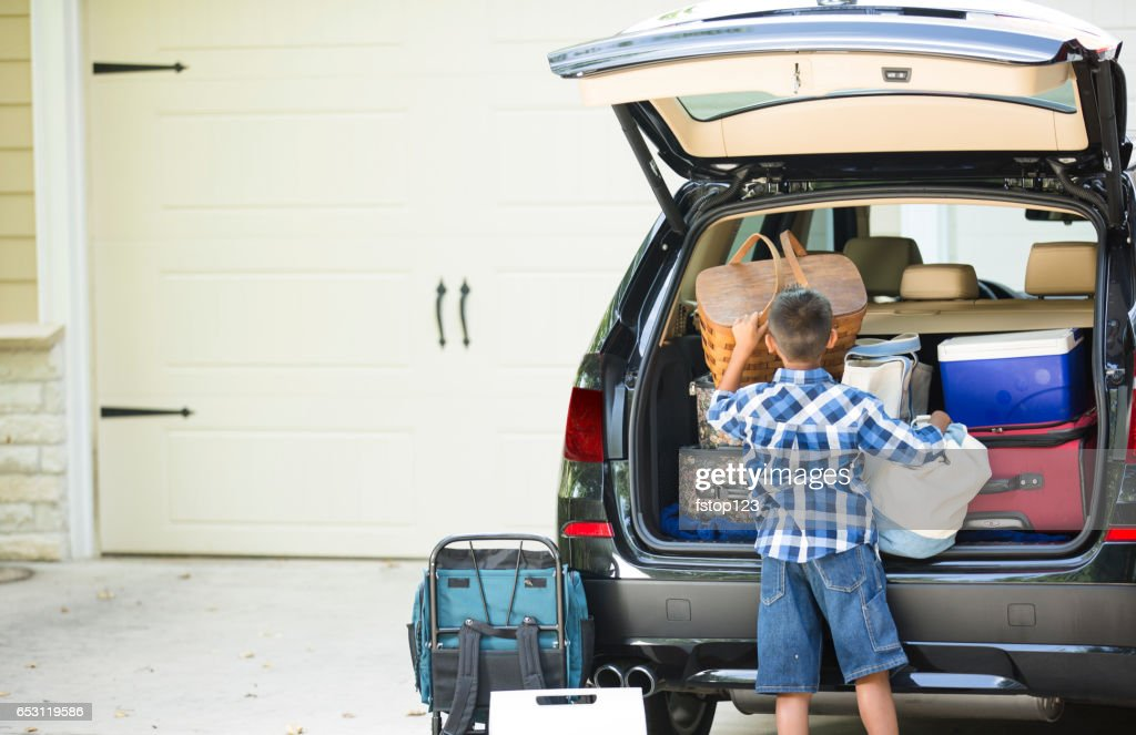 Family packs car for summer vacation. : Stock Photo