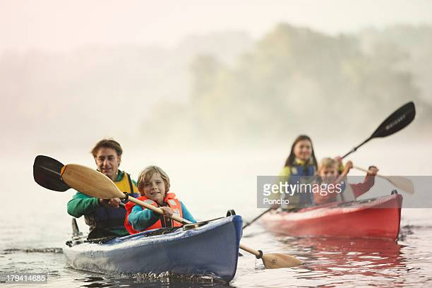Family paddling in a canoe on a lake