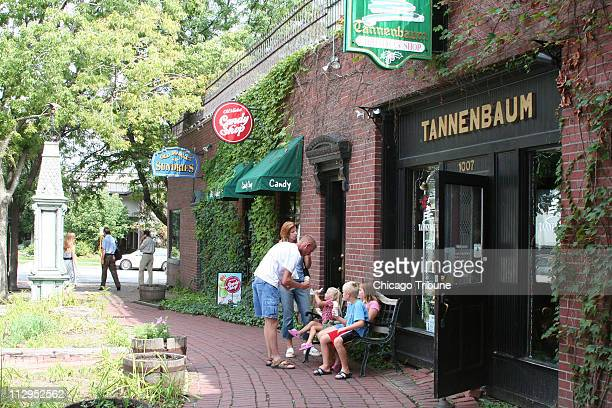 A family pauses for refreshments during a visit to Omaha's Old Market historic district in Omaha Nebraska Vintage buildings now hold shops...