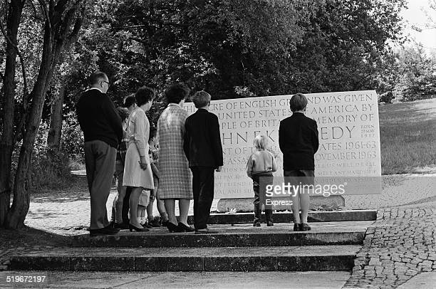 Family pay their respects at the John F Kennedy Memorial after the assassination of Senator Robert Kennedy, Runnymede, Surrey, England, 6th June 1968.