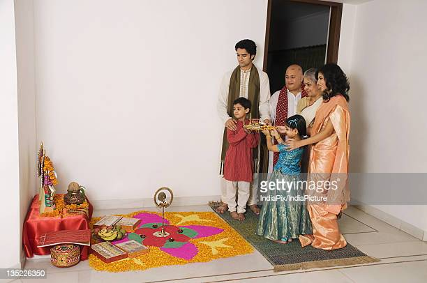 family performing a pooja - asian granny pics stock photos and pictures