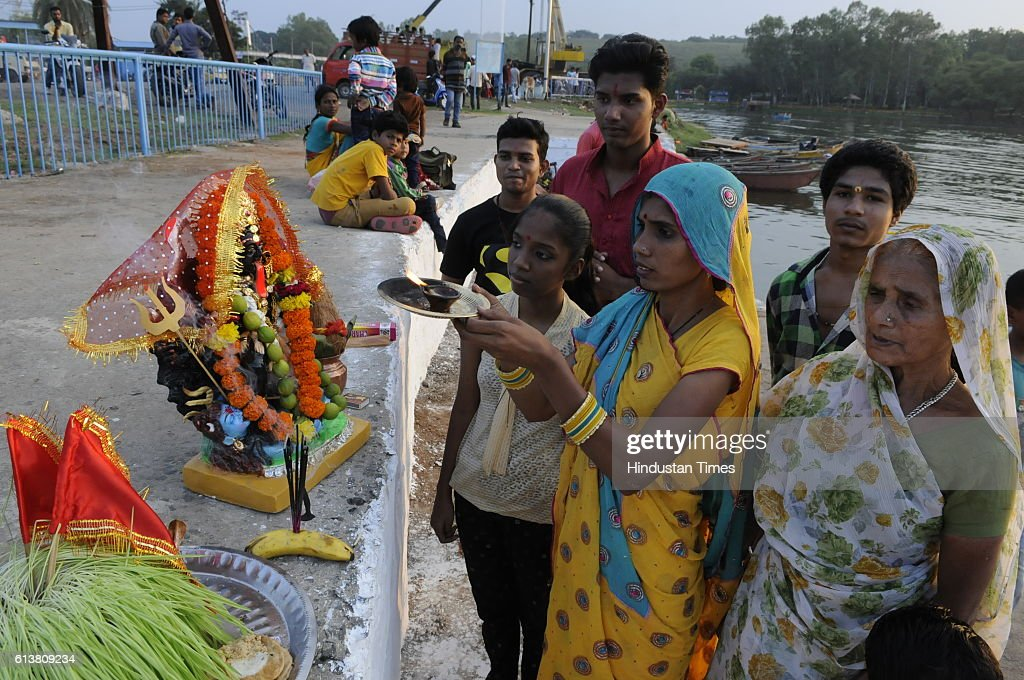 A family performing puja of Goddess Durga before immersion at Prempura Ghat on October 10, 2016 in Bhopal, India.