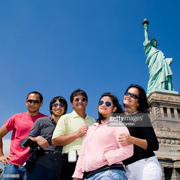 Family photo at Liberty Island, NYC