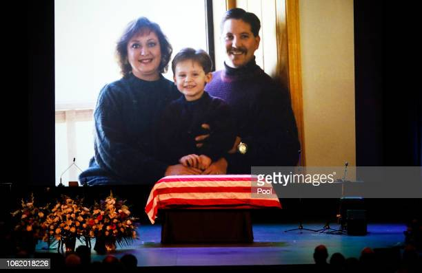 A family photo during a video montage of Ventura County Sheriff Sgt Ron Helus with his wife Karen and son Jordan years ago shown during Memorial...