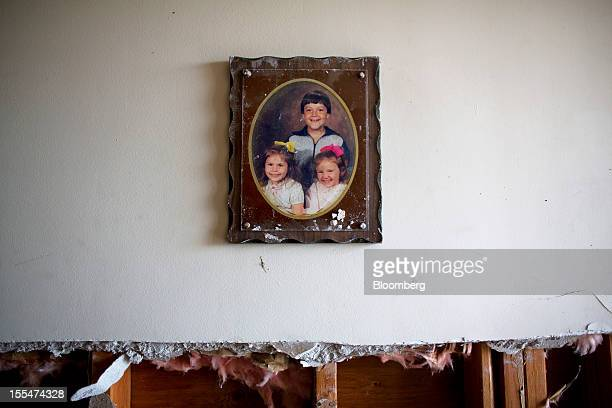 A family photo hangs on the wall of a basement flooded during Hurricane Sandy in Union Beach New Jersey US on Saturday Nov 3 2012 Recovery progressed...