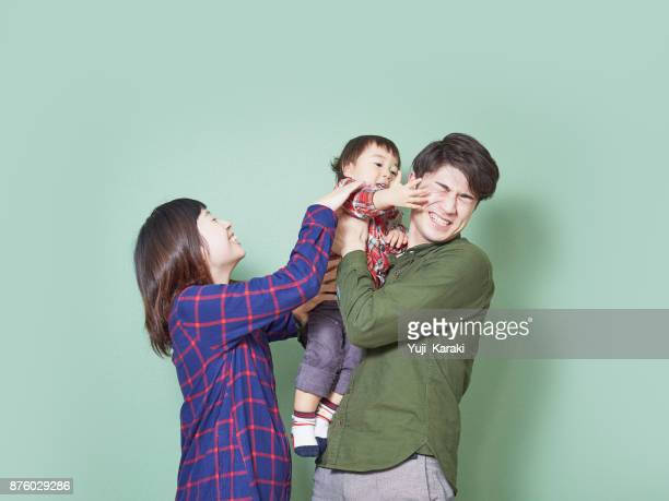 family photo not going well, baby boy slapping daddy
