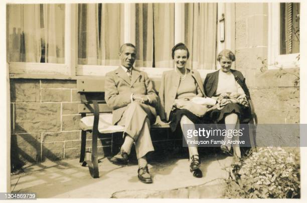 Family photo of British dentist Edward Tull Warnock with his wife Elizabeth, and daughter Jean, around 1940 on holiday at Carrbridge Hotel, Scotland....