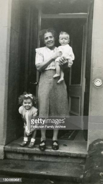 Family photo of Cissie Tull with her great niece Pat and great nephew Duncan in Girvan, Scotland, circa 1948. Cissie Tull is Walter Tull's sister,...