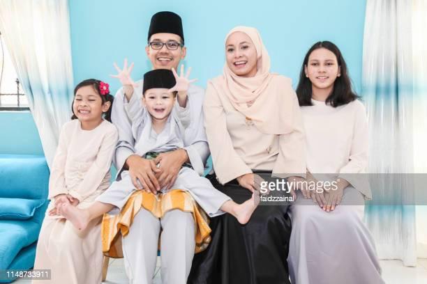 a family photo on hari raya aidilfitri - eid ul fitr photos stock pictures, royalty-free photos & images