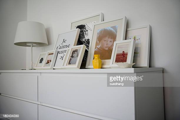 Family photographs displayed on cabinet