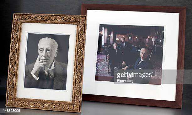 Family photographs of the Rothschilds are seen on the desk of Alexandre de Rothschild executive director of the Rothschild Group and a member of the...