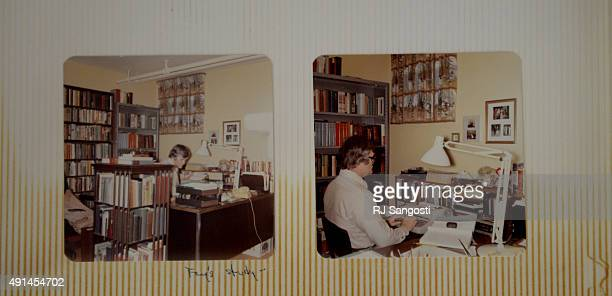 Family photos of Albert Fay Hill working in his study are in an album at his daughter's home October 05 2015